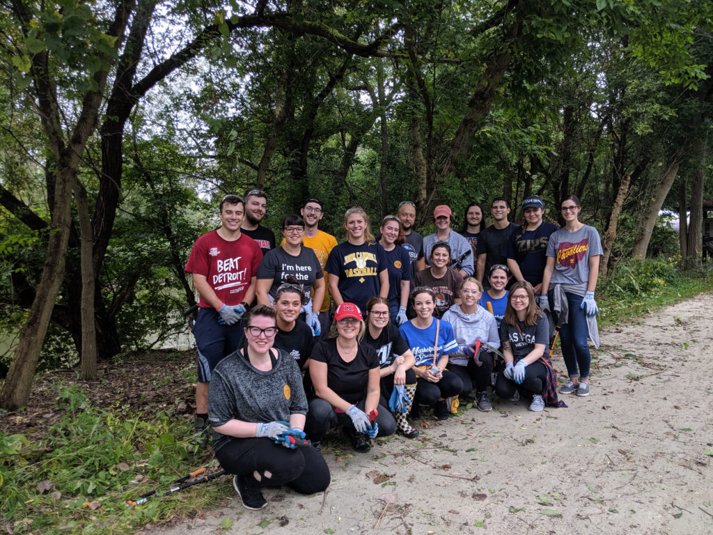 Corporate group volunteering during an invasive species clean up