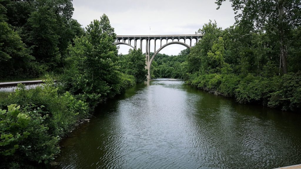 A bridge over the Cuyahoga River surrounded by trees in CVNP.