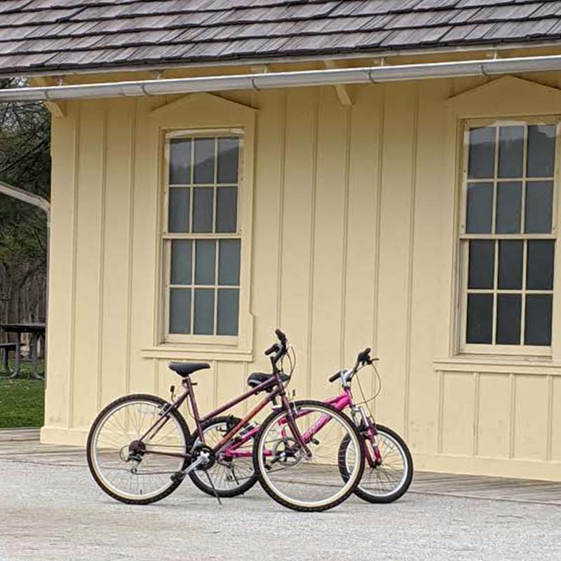 two bikes leaning against train depot