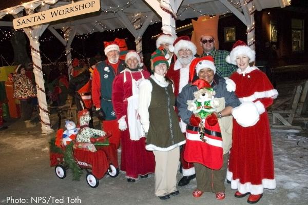 Santa and elves at santa's workshop