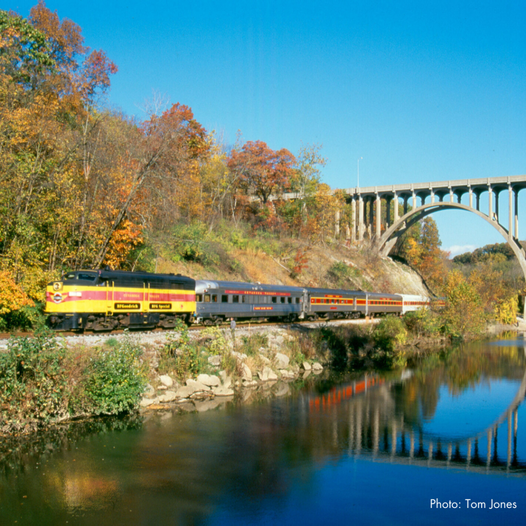 Cuyahoga Valley Scenic Railroad Train passing under bridge during the fall