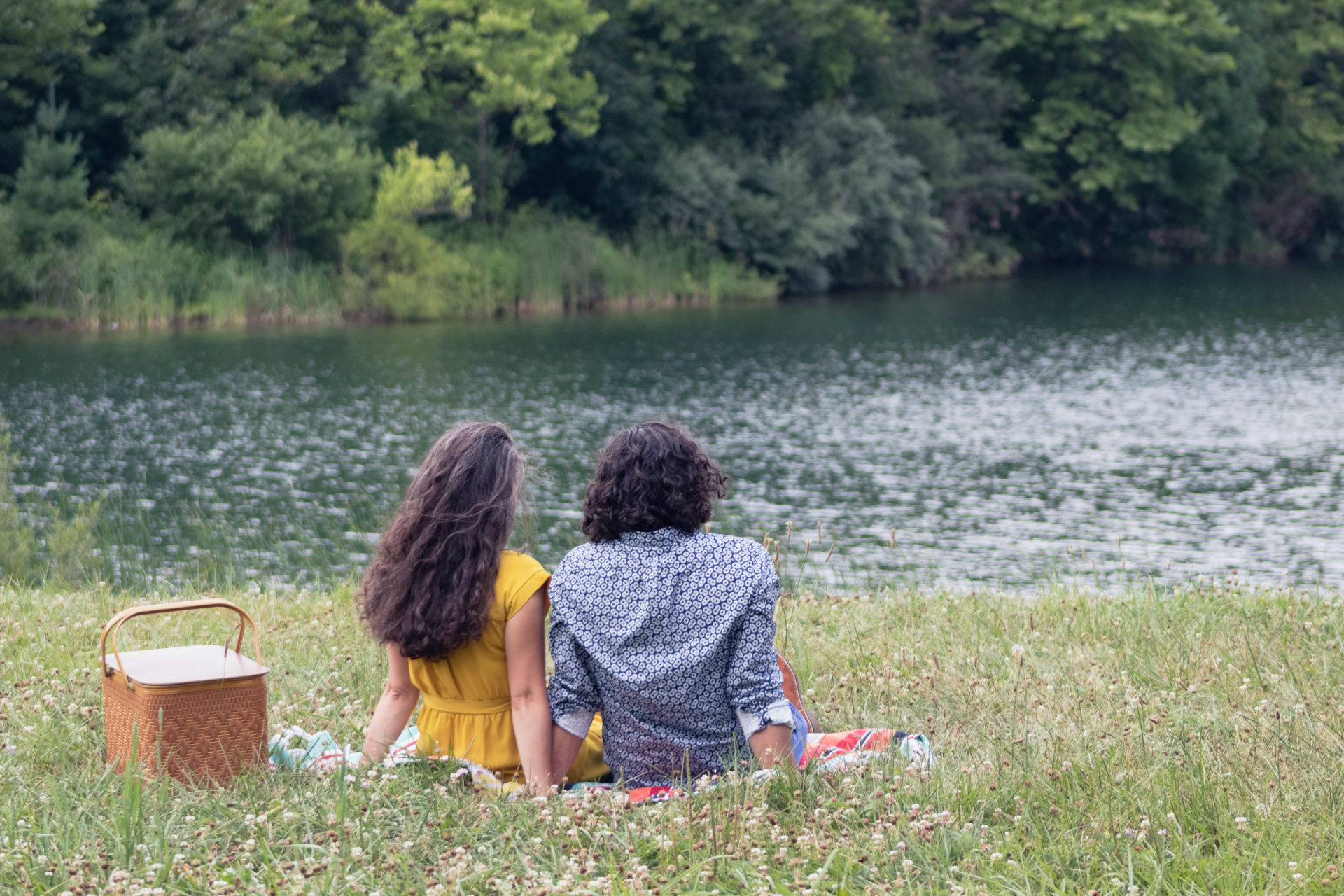 Couple enjoying a picnic by the pond. Photo by Conservancy Staff