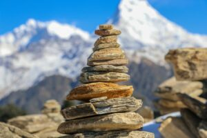 A Rock Cairn with mountains (stacked rocks) in the background