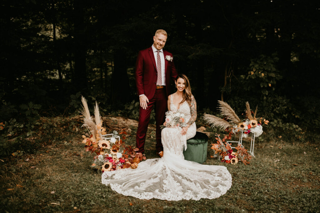 Man and woman pose for a photo outside after their pop-up park wedding