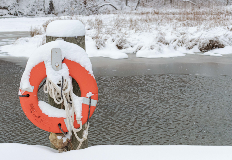 Ring buoy on a snow covered post beside Kendall Lake