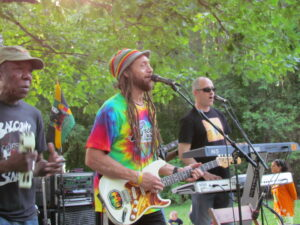 Carlos Jones and the PLUS band play an outdoor concert at Howe Meadow